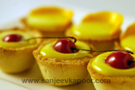 Miniature Tarts With Lemon Curd And Mangoes