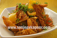Potato Wedges in Schezwan Sauce
